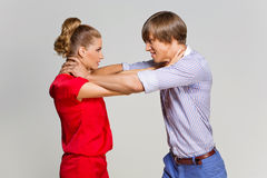 Couple strangling each other Stock Photo