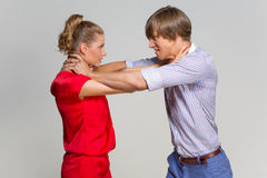 Couple strangling one another Stock Image