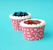 Couple strawberry cupcakes Stock Photos