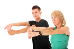 Couple streching. A picture of a young couple streching together over white background Royalty Free Stock Image