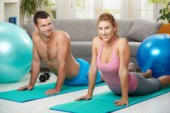 Couple streching abdominal Royalty Free Stock Images