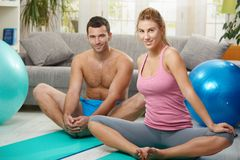 Couple streching before exercises Stock Images
