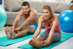 Couple streching legs before exercises Royalty Free Stock Image