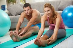 Couple streching legs before exercises Stock Photo