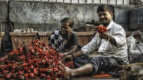 A couple in the street of bombay with lot of roses royalty free stock images