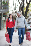 Couple in the street Stock Images