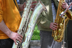 Couple of street saxophonists Stock Photos