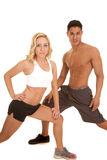 Couple stretch both lunge looking Royalty Free Stock Photography