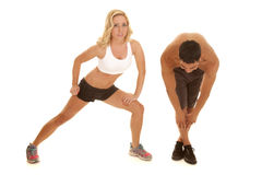 Couple stretch together her lunge Royalty Free Stock Images