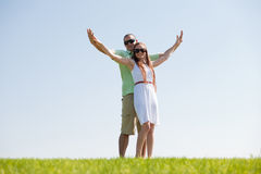 Couple Stretching. Young Couple Stretching Their Hands Together, outdoor stock photography
