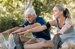 Couple Stretching At Park Royalty Free Stock Images