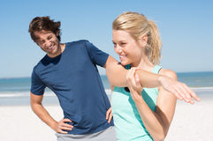 Couple stretching at beach Royalty Free Stock Photo