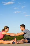 Couple Stretching Groin - vertical Royalty Free Stock Photos