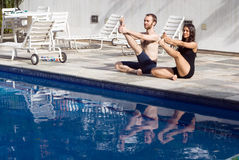 Couple Stretching - Horizontal Stock Images