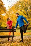 Couple stretching before jogging Stock Images