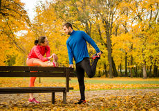 Couple stretching before jogging Stock Photo