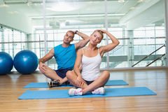 Couple stretching necks in yoga class Stock Images