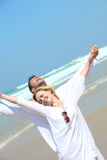 Couple stretching outdoors. Couple on a beach stretching Royalty Free Stock Images