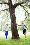 Couple stretching outdoors. Young couple working out outdoors Stock Photo