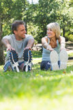 Couple stretching in the park Royalty Free Stock Image