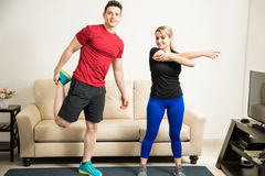 Couple stretching and warming up Royalty Free Stock Image