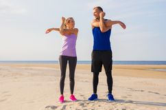 Couple stretching before workout together royalty free stock images