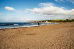 Couple strolling on Ballycastle Beach, Co. Antrim, Northern Ireland Stock Photography