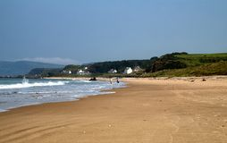 Couple strolling on Ballycastle Beach, Co. Antrim, Northern Ireland Royalty Free Stock Images