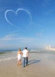 Couple strolling on beach Royalty Free Stock Photo