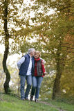 Couple strolling though park Stock Image