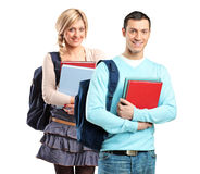 A couple of student holding books. Isolated on white background Royalty Free Stock Photos