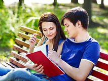 Couple student with notebook outdoor. Royalty Free Stock Photos
