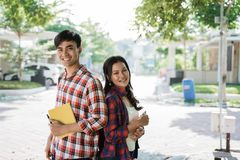 Couple student standing back to back stock images