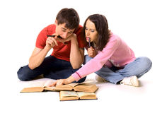 Couple of students. Studying on the floor Royalty Free Stock Photography