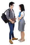 Couple students with books and bags. Standing on white background Stock Images