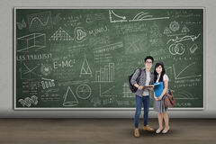 Couple students at classroom Royalty Free Stock Photo