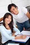 Couple of students at home Stock Photo