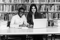 Couple Of Students With Laptop In Library Royalty Free Stock Image