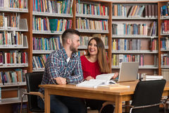 Couple Of Students With Laptop In Library Stock Images