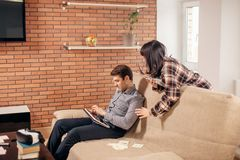 Students learning for examinations together with eBook in home interior. Couple students learning for examinations together with eBook in home interior royalty free stock image