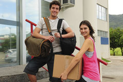 Couple of students moving in to the campus stock images