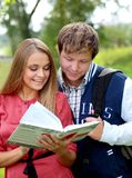 Couple of students with a notebook Royalty Free Stock Photo