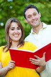 Couple of students outdoors Royalty Free Stock Photography