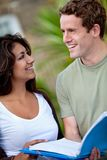 Couple of students outdoors Stock Photography