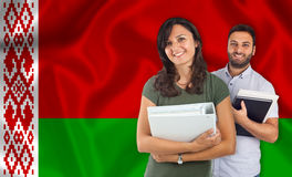 Couple of students over Belarusian flag Royalty Free Stock Images