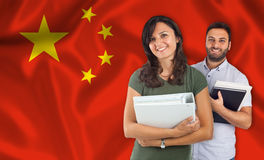Couple of students over chinese flag Royalty Free Stock Photos