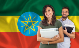 Couple of students over Ethiopian flag Stock Images