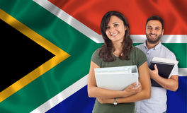 Couple of students over South Africa flag Royalty Free Stock Images