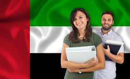 Couple of students over United Arab Emirates flag Stock Images