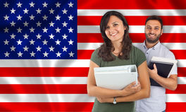 Couple of students over United States flag Royalty Free Stock Images